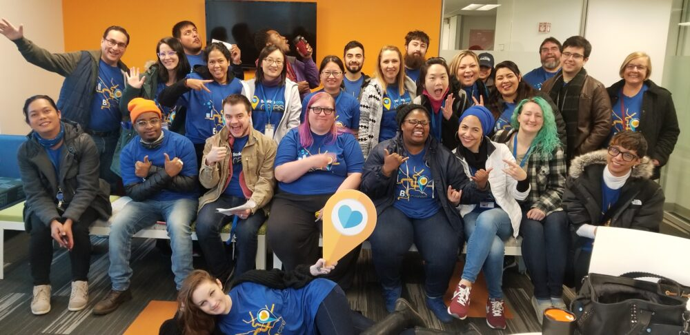 A teamphoto of volunteers wearing blue tshirst