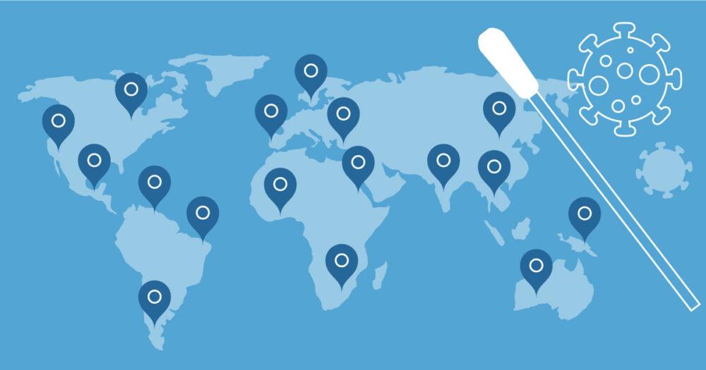 Eine Landkarte mit Pins und ein Stäbchen zudem das Zeichen für den Corona Virus